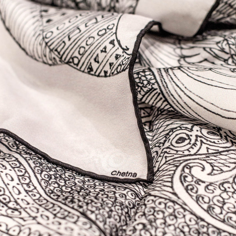 Close-up of Chetna Singh white henna horse print long silk scarf.