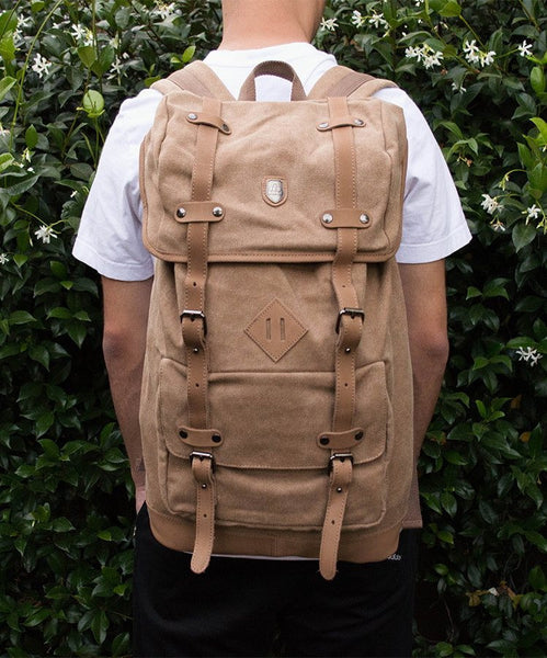 Man wearing the light-brown canvas daypack by Serbags