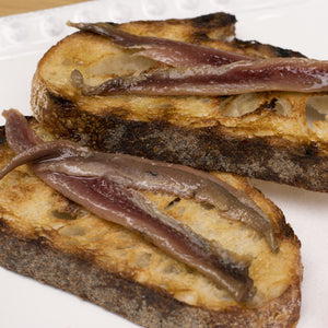 Cantabrian anchovies on grilled toast with olive oil