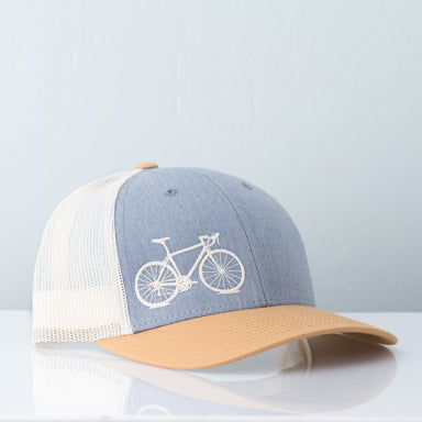 Cream bicycle embroidered on birch mesh back trucker hat