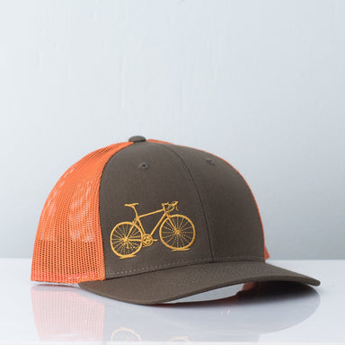 Goldenrod bicycle embroidered on rust mesh back trucker hat