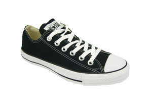 Converse Chuck Taylor All Star ox in youth sizes. black with white sole and laces.