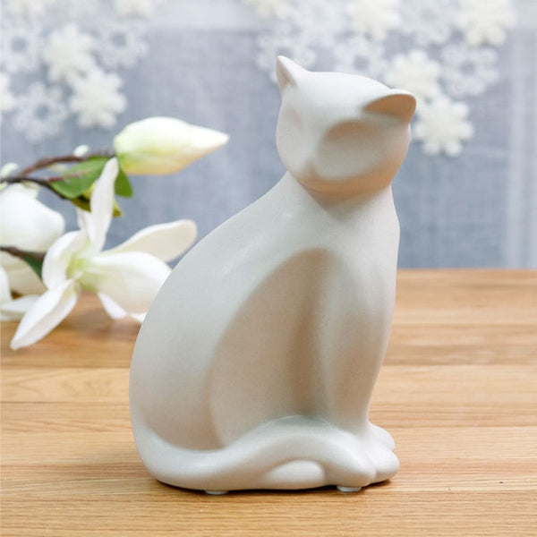 Statuette chat assis