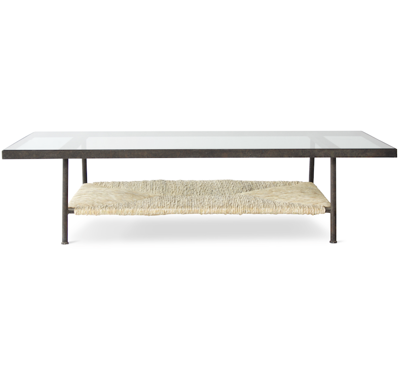 The Canyon Coffee Table is handmade in Los Angeles and designed by Peter Dunham for Hollywood at Home. The iron base, glass top, and rush shelf create an interesting visual mix of materials.