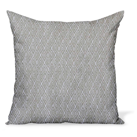A decorative pillow or cushion made from Peter Dunham Textiles linen tribal print, Atlas in Stone, a neutral color