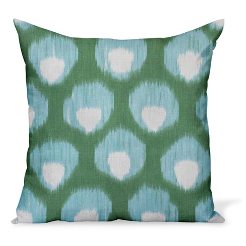A decorative pillow or cushion made from Peter Dunham Textiles linen tribal print, Bukhara in green/blue