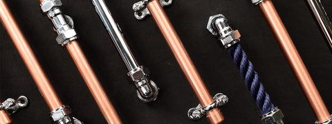 Chrome handles, rope handles, copper drawer pulls and many more designs featured on a black background