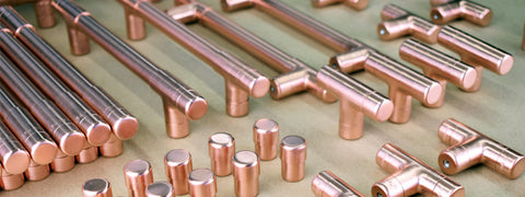 Copper handles, pulls and knobs polished and ready for delivery to the client