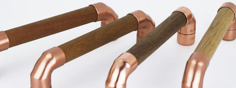 Wood and copper drawer pull photo showing 4 handle designs