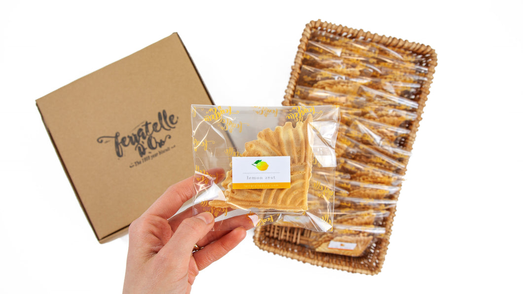 Packets of ferratelle or pizzelle of lemon flavour in a basket