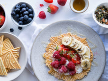 Load image into Gallery viewer, Ferratelle or pizzelle served with strawberries and banana on top