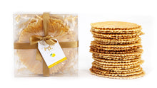 Load image into Gallery viewer, Ferratelle box with a representative tower of ferratelle or pizzelle next to it