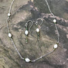Tourmaline Luster Earrings and Necklace handmade in pearls and green tourmaline gemstones by Garden of Silver.