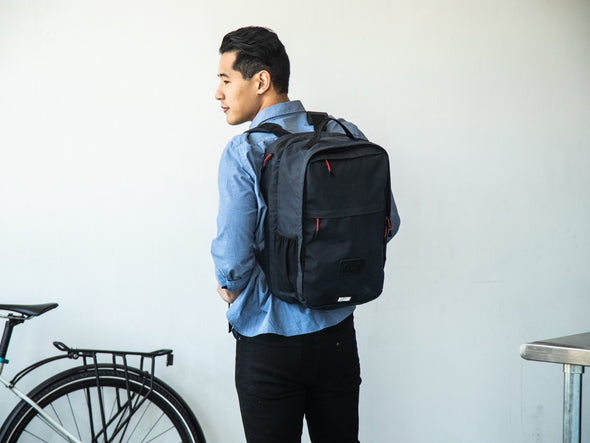 Two Wheel Gear - Pannier Backpack Convertible - Bag on Bike Commuter - Military Waxed Canvas Overcast Blue - On Man