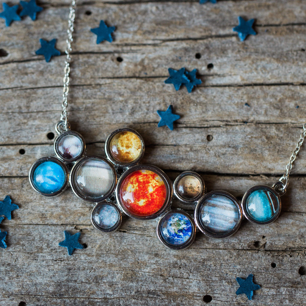 Solar System Necklace - Silver statement pendant including the sun, Mercury, Venus, Earth, Mars, Jupiter, Saturn, Uranus, Neptune, and Pluto - Handmade galaxy jewelry by Yugen Tribe inspired by the cosmos and the universe.