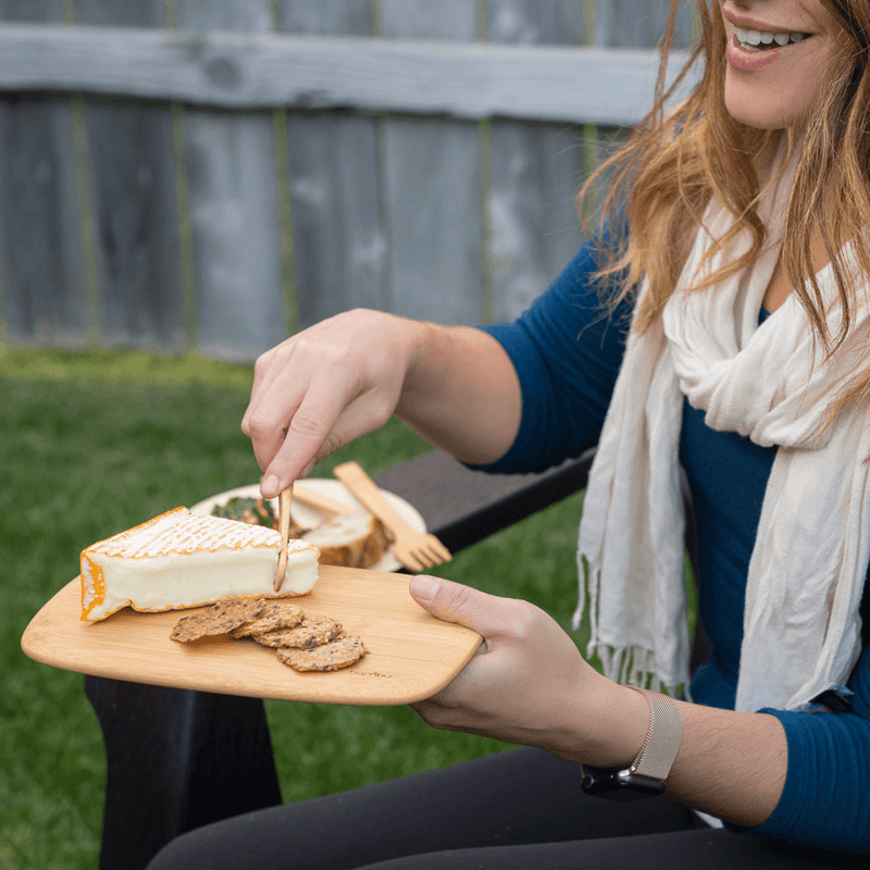 bamboo cutting bar board with cheese and crackers outdoor