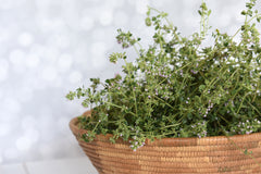 Fresh Thyme Sprigs in Woven Basket