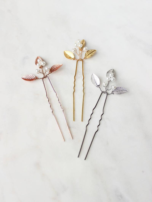 Handspun golden hairpins with delicate gold leaflets and blossoming ivory pearls.