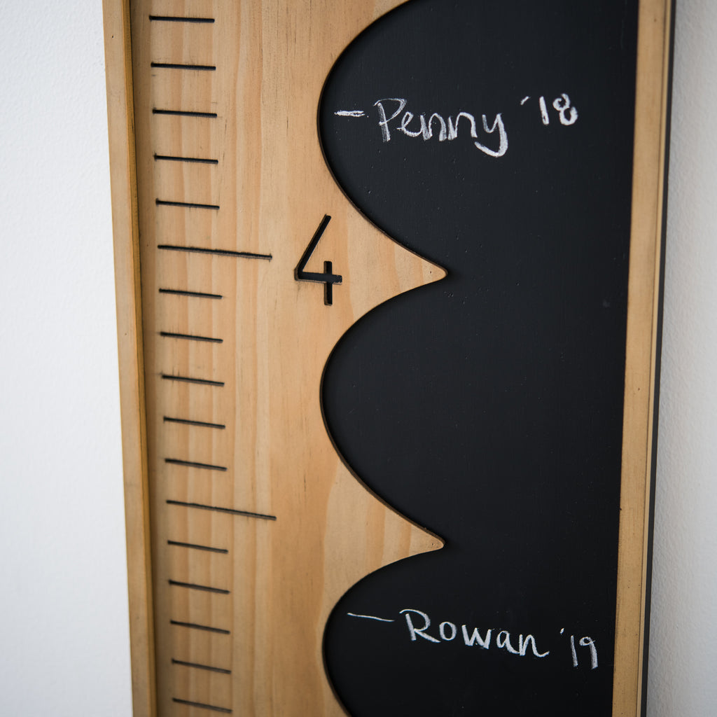 vertical wooden growth chart with side chalkboard