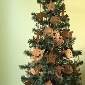 Ocean Animal Christmas Ornaments handmade in eco-friendly bamboo by Graphic Spaces hanging on Christmas tree