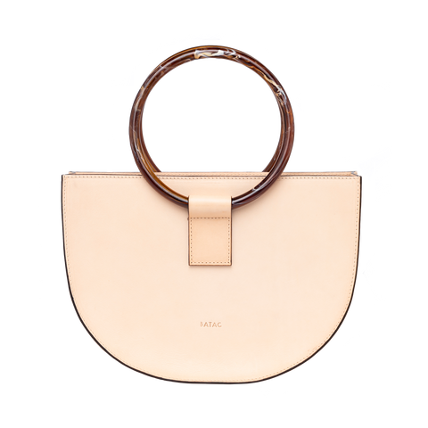 The Watermelon is an artisanal handbag handcrafted in Barcelona with spanish calf leather. A must-have bag with sculptural shape .