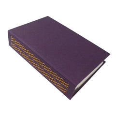 eggplant purple photo album with ornate binding for polaroid photos