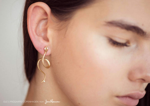 Snakes earring in 18K yellow gold and diamonds