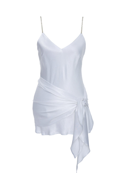 The Aimee Camisole in bright white, with matching sash tied around the waist.