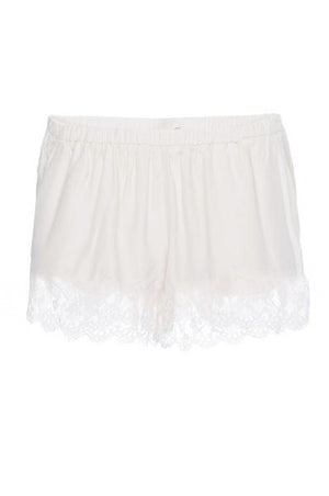 The Marilyn Lace Silk Shorts in white.