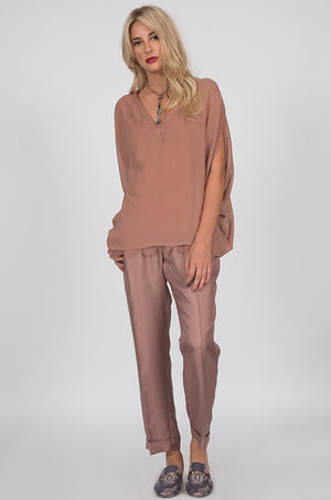 Model is wearing the Silk Twill Cuff Pants in rose taupe with a rose taupe top and tapestry flat mules.