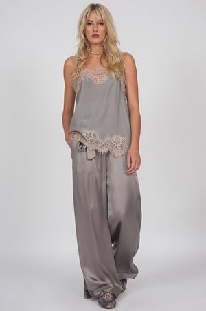 Model is wearing the Hammered Silk Belted Pants in steeple grey with the Coco Lace Silk Straight Cami in steeple grey birch.