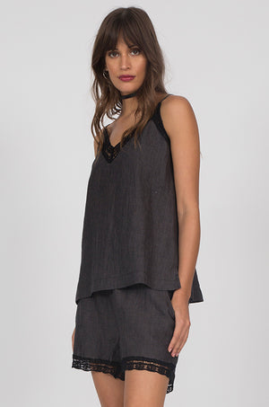 Model is wearing the Capri Linen Cami in black with Linen Capri Shorts in black.