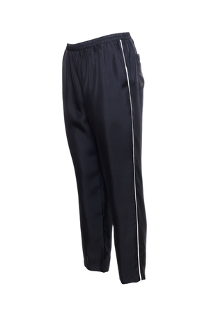 The Silk Twill Piping Pants in black; side view.