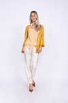 Model is wearing the Mini Stripe Camisole in gold with the Silk Twill Cuff Pants in dove and the Silk Wrap Top in gold. Also worn with reddish orange, pointed toe, kitten heels, and a gold colored scarf.