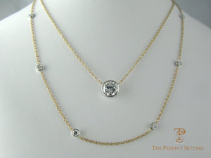 Diamond solitaire with diamond necklace