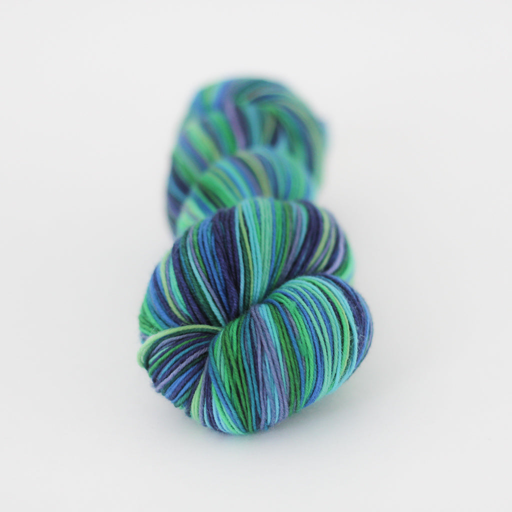 Azurite A self-striping green and blue sock knitting yarn from Gauge Dye Works