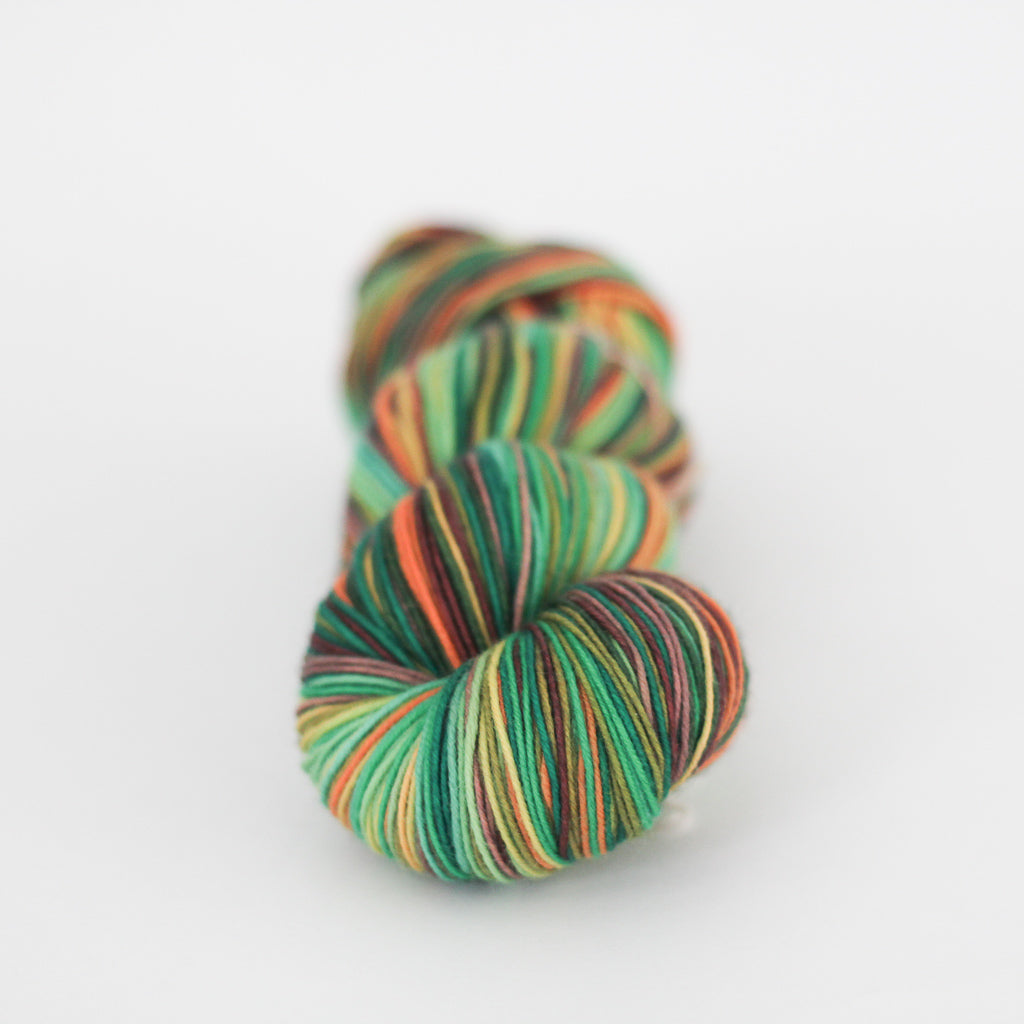 Azurite E green and orange self striping classic sock yarn from gauge dye works