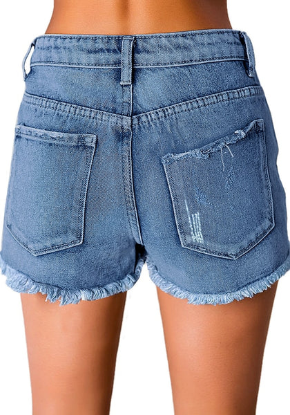 Back view of model in light blue mid-waist raw hem distressed denim shorts