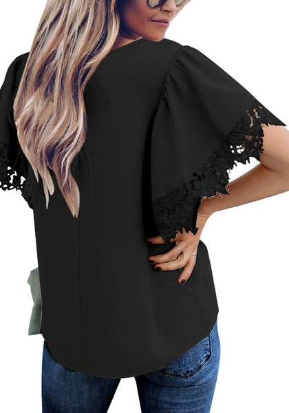 Back view of model wearing black flutter sleeves lace trim loose blouse