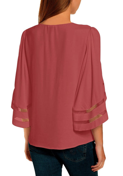 Back view of model wearing coral pink 34 bell mesh panel sleeves tie-front button-up loose top