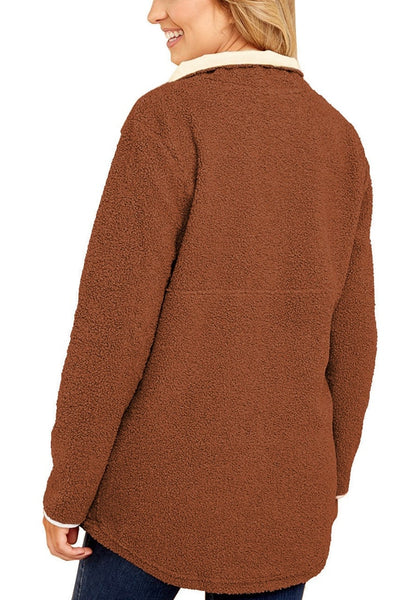 Back view of model wearing dark orange button-front fleece pullover