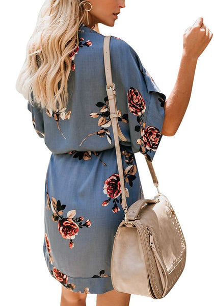 Back view of model wearing light blue V-neck floral belted kimono dress