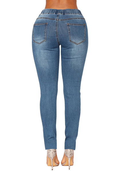 Back view of model wearing medium blue drawstring-waist washout ripped skinny jeans