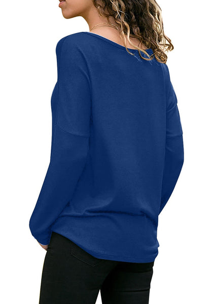 Back view of model wearing royal blue long sleeves color block tunic top