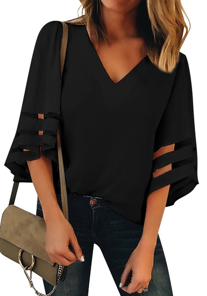 Front view of model wearing  black 3/4 bell mesh panel sleeves V-neckline loose top