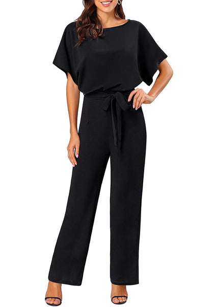 Front view of model wearing black short sleeves keyhole-back belted jumpsuit