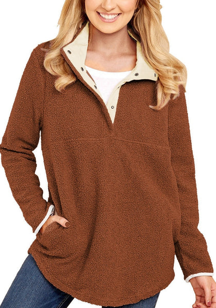 Front view of model wearing dark orange button-front fleece pullover