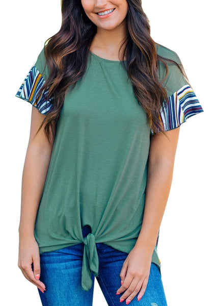 Front view of model wearing green ruffle short sleeves tie-front blouse