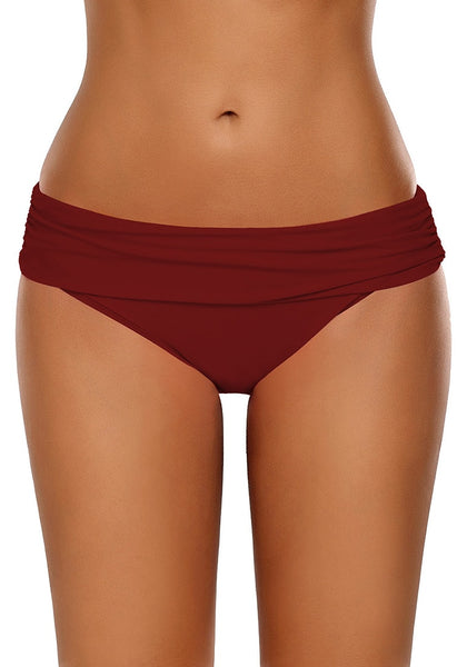 Front view of model wearing red shirred waistband swim bottom