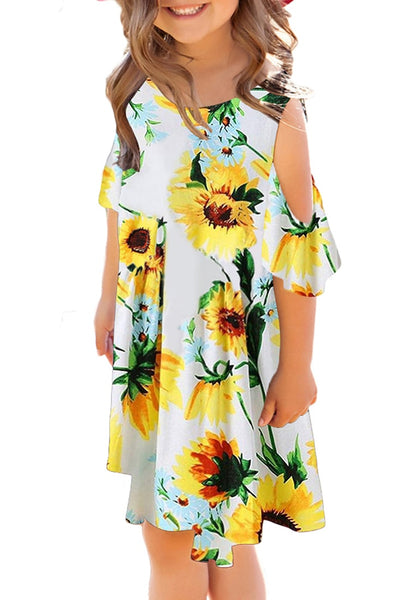 Front view of model wearing yellow cold-shoulder floral short sleeves girl tunic dress